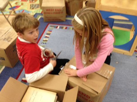 Porter taping boxes
